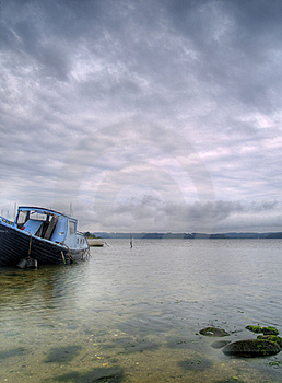 Old Abandoned Boat Floating Near The Shore Royalty Free Stock Photo - Image: 14236585