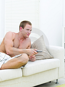 Muscular Man Watching TV Stock Photos - Image: 14236943