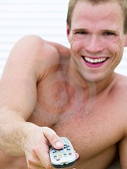 Muscular Man Watching TV (focus On Remote) Stock Photos - Image: 14236953