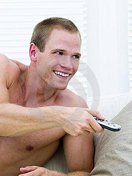 Muscular Man Watching TV Royalty Free Stock Images - Image: 14236969