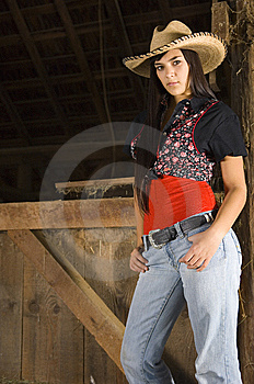 Cowgirl On Hay Royalty Free Stock Image - Image: 14268716