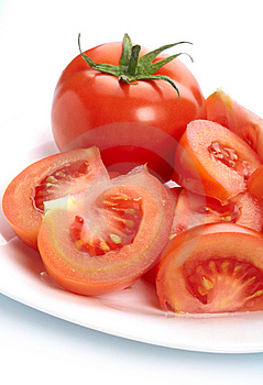 Tomato And Slices On Plate Royalty Free Stock Photography - Image: 14274367