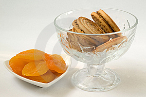 Dried Apricots On Plate And Cookies In A Vase Stock Images - Image: 14287994