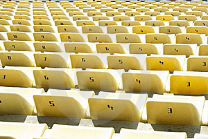 Yellow Chairs On A Soccer Stadium Royalty Free Stock Image - Image: 14299866