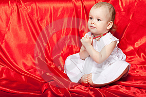 Cute Baby On The Red Silk Cloth Royalty Free Stock Photography - Image: 14304687