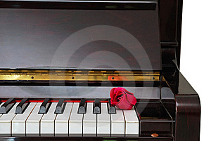 Single Red Rose On Piano Royalty Free Stock Photography - Image: 14312127