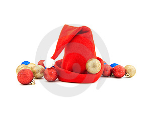 Red Cap And Christmas-tree Decorations Stock Photo - Image: 14323430