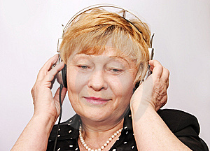 Old Woman Listens To Music Stock Photo - Image: 14336790