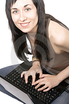 The Smiling Girl Works With The Laptop Stock Images - Image: 14338574