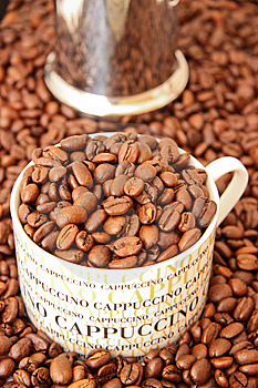 Coffee Beans In A Cappuccino Cup Royalty Free Stock Photos - Image: 14340188