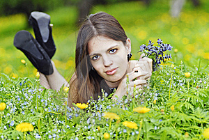 Girl Lying In A Grass With A Bunch Of Flowers Stock Photos - Image: 14349923