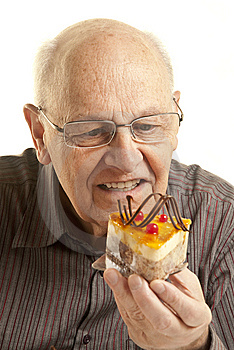 Senior Man Eating A Cake Royalty Free Stock Photography - Image: 14353677