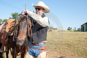 Cowboy And His Horse Royalty Free Stock Photo - Image: 14359215