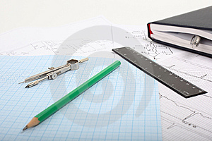 Compass On A Graph Paper With Notepad Stock Photography - Image: 14359882