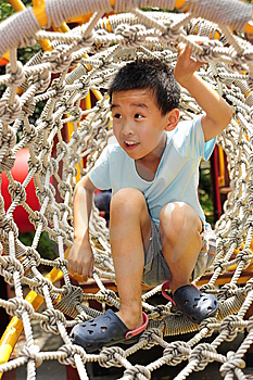 A Child Climbing A Jungle Gym. Stock Photography - Image: 14363982
