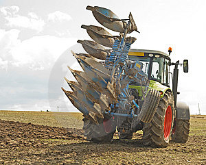 Tractor Turning With A Raised Plow. Royalty Free Stock Image - Image: 14374006