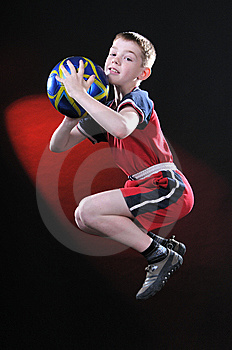 Boy In Jump Catches A Soccer Ball Royalty Free Stock Image - Image: 14376746