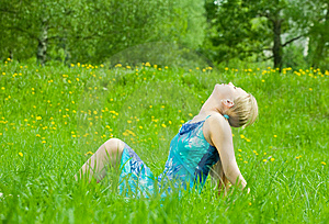 Girl Rests On The Grass Stock Photography - Image: 14383442