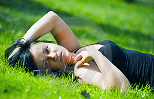 Portrait Of Beautiful Brunette Lying On Grass Royalty Free Stock Photo - Image: 14384675