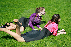 Young Businesswomen Relaxing On The Grass Royalty Free Stock Images - Image: 14398149