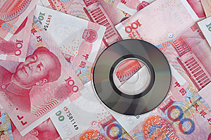 Money Bill And Compact Disk Royalty Free Stock Image - Image: 14403516
