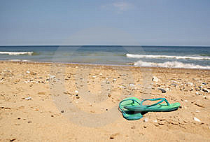 Green Flip Flops On Beach Royalty Free Stock Photo - Image: 14411735