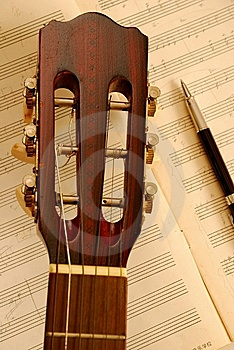 Guitar With Pen On Music Manuscript Royalty Free Stock Photos - Image: 14415428