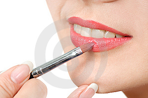 Applying liquid glossy lipstick Stock Photography