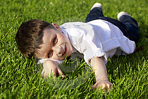 Boy Lying On Grass Royalty Free Stock Photography - Image: 14431187
