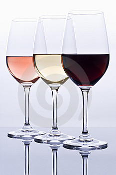 Wineglasses Filled with Colorful Wine Stock Images