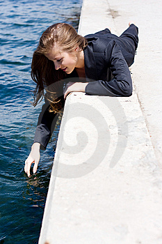 Woman Near The Water Royalty Free Stock Image - Image: 14448556