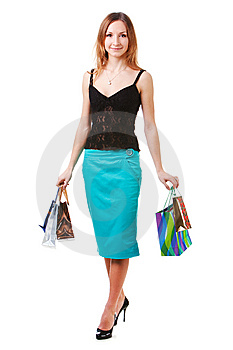 Attractive Young Lady In Blue Skirt With Packets Stock Images - Image: 14448674