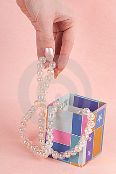 Hand With Pearl Beads Stock Photography - Image: 14461962
