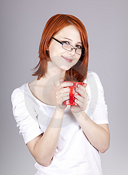 Red-haired Businesswoman  Keep Red Cup In Hand Royalty Free Stock Photos - Image: 14470488