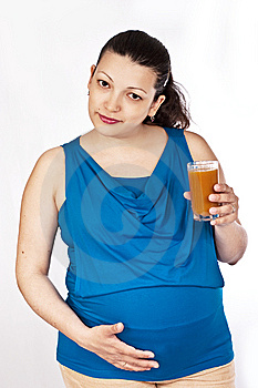 Pregnant Girl Holds Glass Of Apricot Juice Royalty Free Stock Photos - Image: 14480018