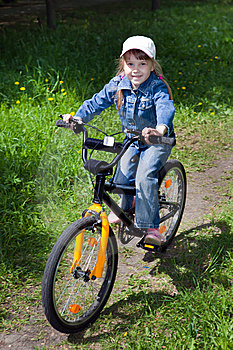 The Girl On A Bicycle Royalty Free Stock Photography - Image: 14487017