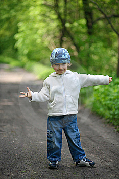 Little Boy In A Forest Royalty Free Stock Image - Image: 14494786