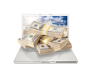 Laptop With Stacks Of Money Coming From Screen Royalty Free Stock Photography - Image: 14503607