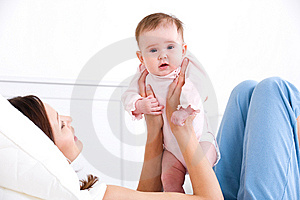 Baby On The Mother's Hands Royalty Free Stock Image - Image: 14510076
