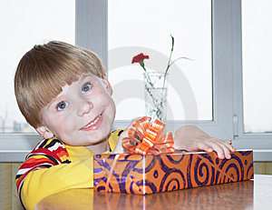 The Boy With A Gift Stock Images - Image: 14553534