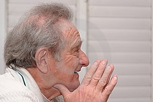 Smiling Elderly Man Resting His Head On Hands Stock Photos - Image: 14581523