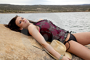 Woman Resting On Rock By Water Royalty Free Stock Photo - Image: 14584415