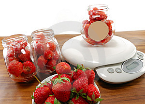 Strawberries In Bowl On The Scales Royalty Free Stock Photo - Image: 14593645