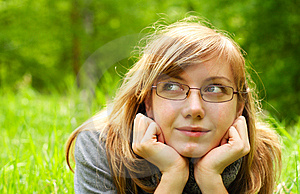 The Young Girl,  Lays On A Green Grass, In Park Royalty Free Stock Photos - Image: 14600118