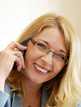 Businesswoman Speaking By Mobile Phone Royalty Free Stock Images - Image: 14605649