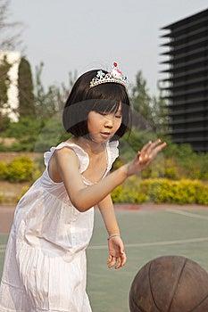 Asian Girl Bouncing Basketball Royalty Free Stock Photo - Image: 14606405