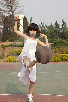 Asian Girl And Basketball Royalty Free Stock Photography - Image: 14606407