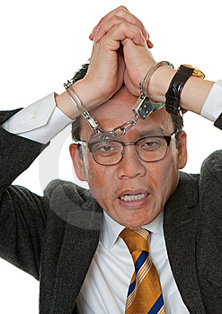 Businessman With Handcuffs Royalty Free Stock Photo - Image: 14627485