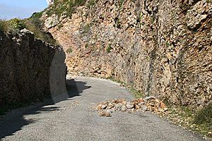 Dangerous Boulders At A Country Road Royalty Free Stock Image - Image: 14634406