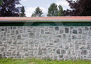 Stone Wall With Red Roof Stock Photo - Image: 14636880